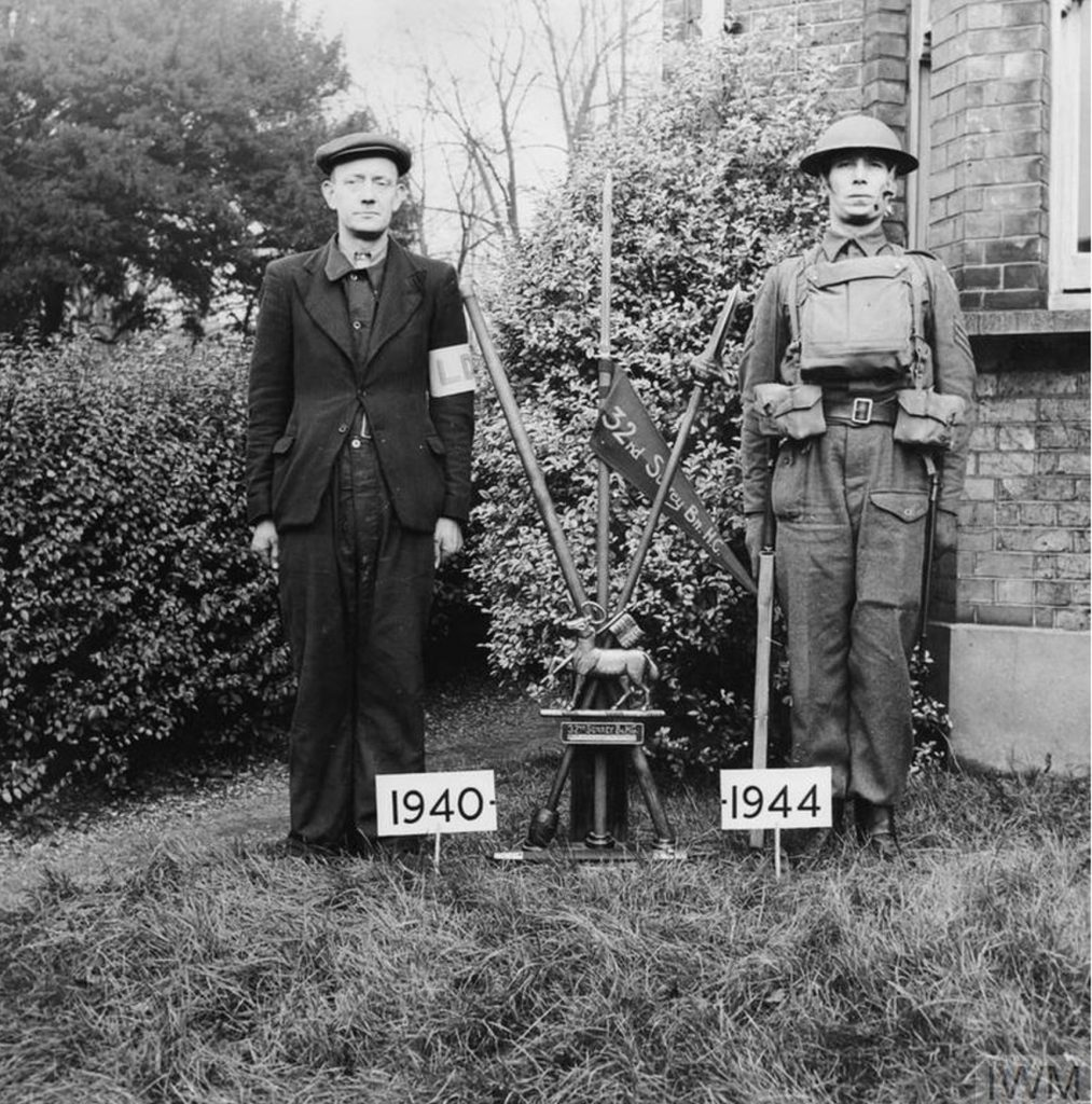 This photograph clearly shows the contrast between a 1940 Local Defence Volunteer and a member of the Home Guard in 1944.